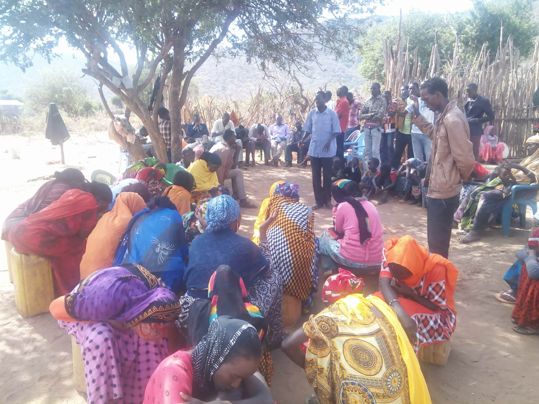 brothers william and Johsua worship and prayer muslims gmfc Kenya church under tree 33