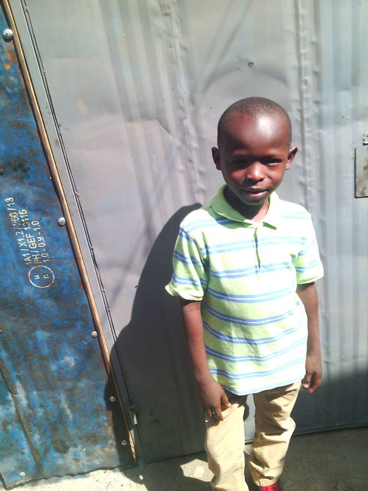 Barack Omondi age 6 male grade 2 third in family of four- be Doctor