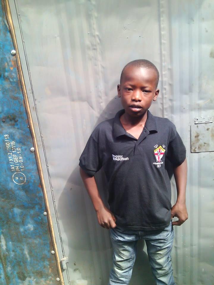 John Odhiambo age 8 male grade 3 first born family of 4-be Doctor