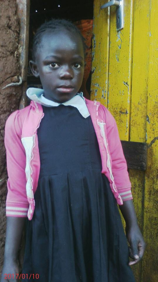 Rose Adhiambo age 8 grade 2 have mother only first born in 4 children would like to be a teacher.